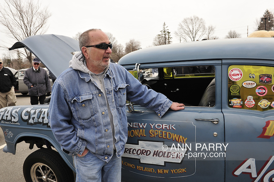 """ALEX RECINE, of West Babylon, is with his 1955 Chevrolet sedan, a Gasser A/Gas class racing car, with name """"Gas Chamber"""" written on its side, at the 58th Annual Easter Sunday Vintage Car Parade and Show sponsored by the Garden City Chamber of Commerce. Hundreds of authentic old motorcars, 1898-1988, including antiques, classic, and special interest participated in the parade."""