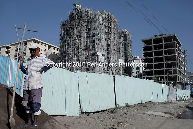 ADDIS ABABA, ETHIOPIA - NOVEMBER 17: An old man works at a construction site on November 1, 72010 in Addis Ababa, Ethiopia. Hundreds of building are being built in the city, hotels, offices and residential apartments.(Photo by Per-Anders Pettersson)
