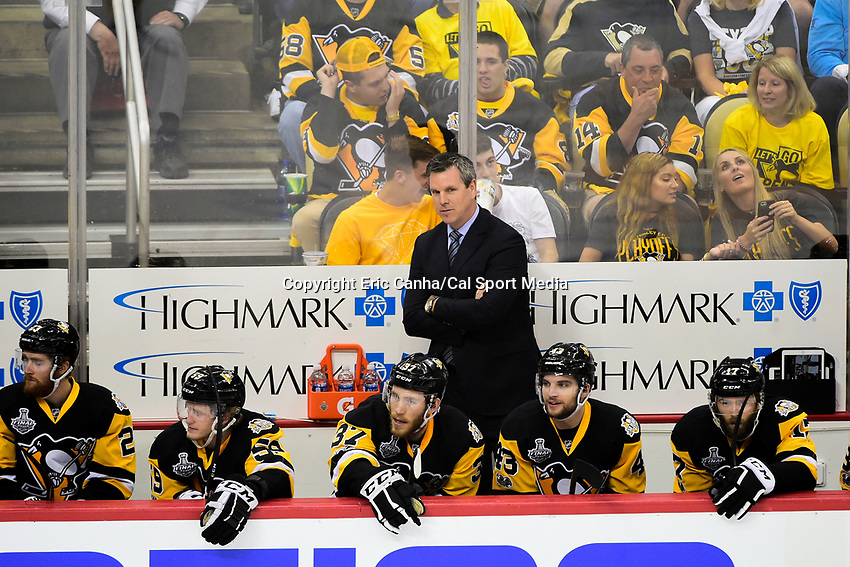 May 31, 2017: Pittsburgh Penguins head coach Mike Sullivan reacts to a ruling on the ice during game two of the National Hockey League Stanley Cup Finals between the Nashville Predators  and the Pittsburgh Penguins, held at PPG Paints Arena, in Pittsburgh, PA. The Penguins defeat the Predators 4-1 and lead the series 2-0. Eric Canha/CSM