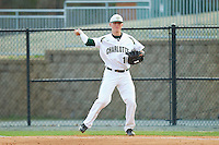 Justin Seager #10 of the Charlotte 49ers makes a throw to first base against the Tennessee Tech Golden Eagles at Robert and Mariam Hayes Stadium on March 8, 2011 in Charlotte, North Carolina.  Photo by Brian Westerholt / Four Seam Images
