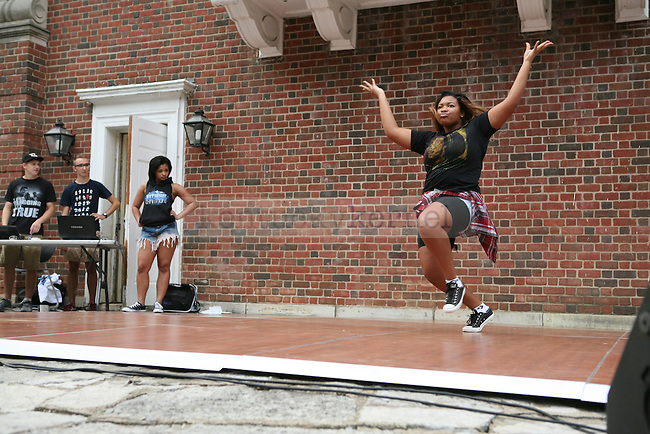 A performer dances during We Are UK in Lexington, Ky., on Tuesday, August 27, 2013. Photo by Adam Pennavaria | Staff