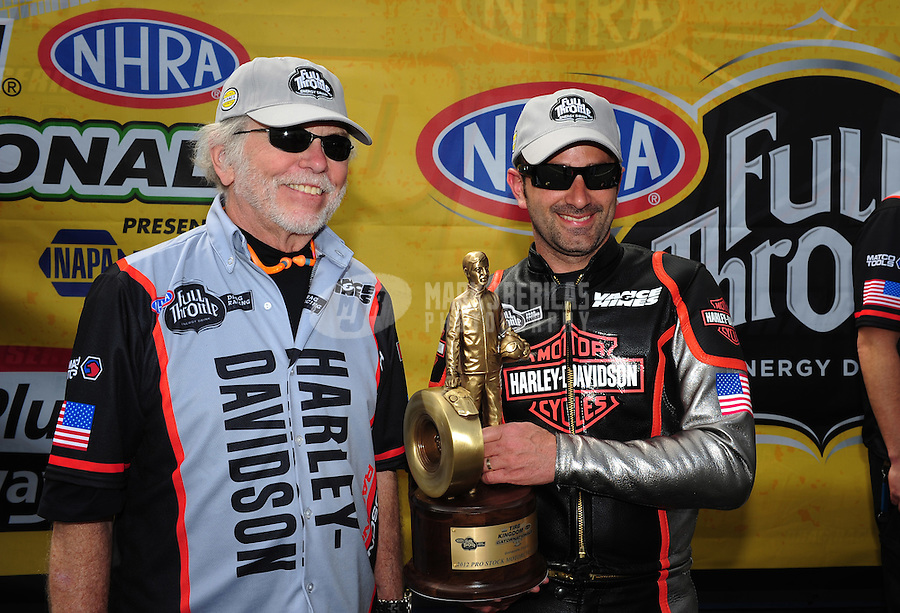 Mar. 12, 2012; Gainesville, FL, USA; NHRA pro stock motorcycle rider Eddie Krawiec (right) celebrates after winning the Gatornationals at Auto Plus Raceway at Gainesville. The race is being completed on Monday after rain on Sunday. Mandatory Credit: Mark J. Rebilas-