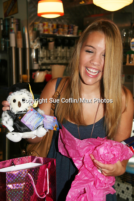 One Life To Live's Kristen Alderson with gifts from fans at her annual Fan Gathering on August 16, 2009 at Big Daddy's Diner, New York City, New York. Great time. (Photo by Sue Coflin/Max Photos)