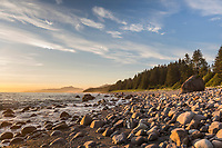 Sunset and rocky beach along the Gulf of Alaska, Mt. Fairweather, Pacific Ocean coast, Glacier Bay National Park, Southeast, Alaska