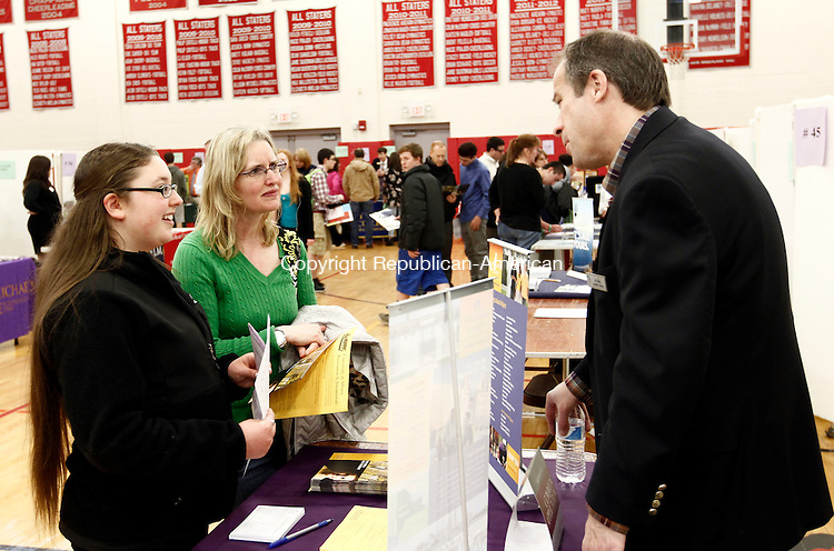 Southbury, CT- 23 April 2014-042314CM10-  Cara Lomaro, a sophomore at Pomperaug High School and her mom, Yvette Lomaro talk with JR Gaige, Associate Director of Undergraduate Admissions at University at Albany during a college fair at Pomperaug High School in Southbury on Wednesday. Over 100 colleges, universities, technical schools and military representatives were on hand for the fair.   Christopher Massa Republican-American