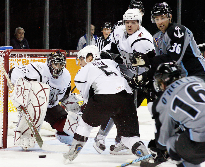 Rampage goalie Al Montoya, left, and teammates Rob Bina, center, and Jeff May guard the net against Milwaukee's Cal O'Reilly, right, and Dave Scatchard during the first period of an AHL hockey game between the Milwaukee Admirals and the San Antonio Rampage, Tuesday, Nov. 24, 2009, at the AT&T Center in San Antonio. (Darren Abate/pressphotointl.com)