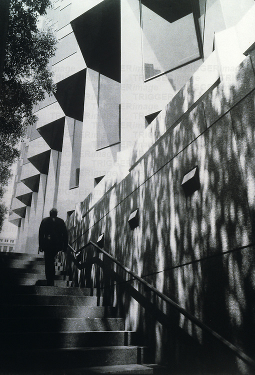 man ascending stairs in San Francisco, California