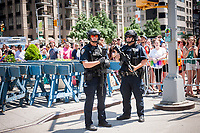 NYPD Counterterrorism officers stand guard during the annual Lesbian, Gay, Bisexual,Transgender and Queer (LGBTQ) Pride Parade on Fifth Avenue in New York on Sunday, June 25, 2017. Besides the corporate sponsors, politicians and various social service groups many participants carried political themed signs showing their dissatisfaction with President Trump. (© Richard B. Levine)
