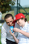 ISPS Handa Wales Open Golf final day at the Celtic Manor Resort in Newport, UK. :  Julien Quesne of France poses for a selfie with a young golf fan after finishing his round.