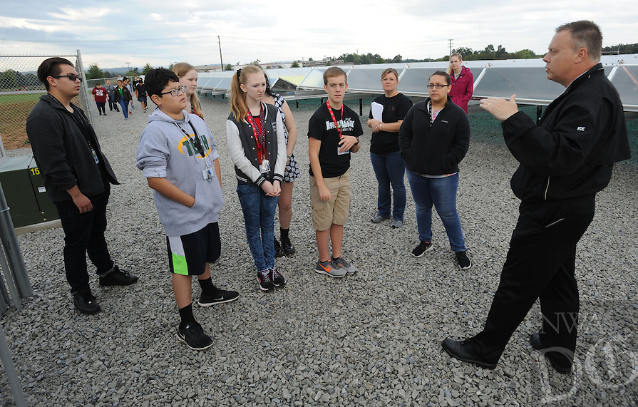 NWA Democrat-Gazette/ANDY SHUPE<br /> Troy Scarbrough (right), vice president of engineering and operations for Ozarks Electric Cooperative Corporation, speaks Wednesday, Oct. 5, 2016, to a group of students from the Don Tyson School of Innovation in Springdale as the students tour Arkansas' first member-owned, utility-scale solar generation facility in Springdale. Every student at the school toured the site with members of the cooperative's engineering team as a part of the school's Real World Curriculum and partnership with the cooperative.