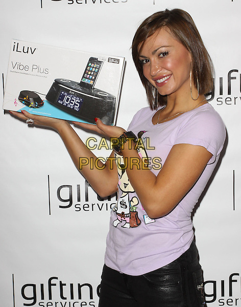 KARINA SMIRNOFF.Visits Gifting Services Inc held At El Gifting Services Showroom,  West Hollywood, California, USA, .24th April 2010..**EXCLUSIVE ALL ROUNDER**.half length purple t-shirt tee holding ipod player product iluv box .CAP/ADM/FS.©Faye Sadou/AdMedia/Capital Pictures.