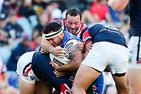 Jazz Tevaga takes a forearm across the nose. Sydney Roosters v Vodafone Warriors, NRL Rugby League. Allianz Stadium, Sydney, Australia. 31st March 2018. Copyright Photo: David Neilson / www.photosport.nz