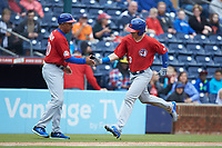 Reese McGuire (3) of the Buffalo Bison slaps hands with third base coach Bob Meacham (10) as he rounds the bases after hitting a 2-run home run against the Durham Bulls at Durham Bulls Athletic Park on April 25, 2018 in Allentown, Pennsylvania.  The Bison defeated the Bulls 5-2.  (Brian Westerholt/Four Seam Images)