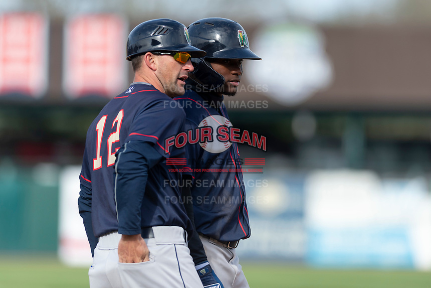 Cedar Rapids Kernels Yeltsin Encarnacion (43) talks to manager Brian Dinkelman (12) after reaching third base during a Midwest League game against the Kane County Cougars at Northwestern Medicine Field on April 28, 2019 in Geneva, Illinois. Kane County defeated Cedar Rapids 3-2 in game one of a doubleheader. (Zachary Lucy/Four Seam Images)