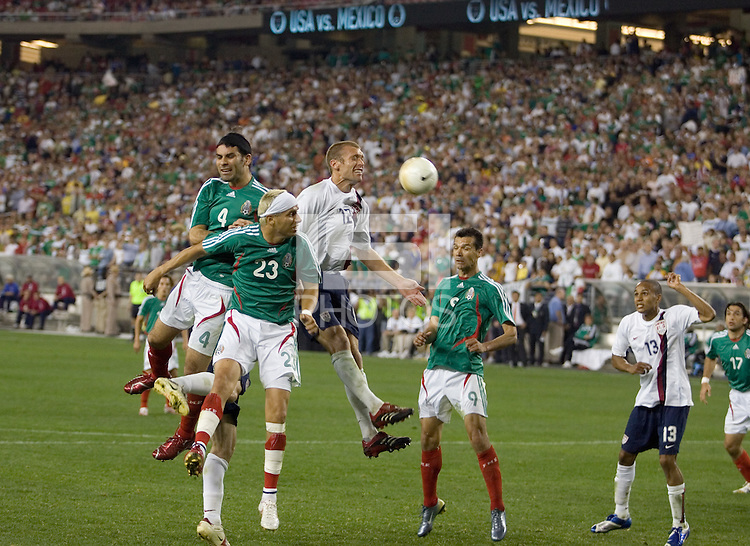 Jimmy Conrad heads the ball away from Mexico's Adolfo Baustista (23) and Rafael Marquez (4) during a 2-0 victory over Mexico, in Glendale, AZ, Wednesday, Feb. 7, 2006.