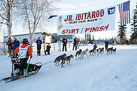 First place winner, Kevin Harper runs across the finish line of the 2016 Junior Iditarod in Willow, Alaska, AK  February 28, 2016