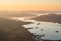 Autumn sunrise over lake Laitaure from summit of Skierfe, near Aktse hut, Kungsleden trail, Lapland, Sweden