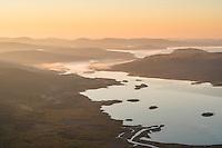 Autumn sunrise over lake Laitaure from summit of Skierfe, near Aktse hut, Kungsleden trail, Lapland, Sweden
