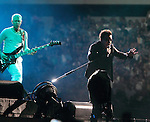 Adam Clayton and Bono of U2 perform on the bands 360? Tour at Lincoln Financial Field in Philadelphia, Pennsylvania, USA July 14, 2011. Copyright EML/Rockinexposures.com.