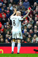 Sunday, 23 February 2014<br /> Pictured: Swansea City's Jonjo Shelvey acknowledges The Kop at Liverpool after scoring his goal<br /> Re: Barclay's Premier League, Liverpool FC v Swansea City FC v at Anfield Stadium, Liverpool Merseyside, UK.