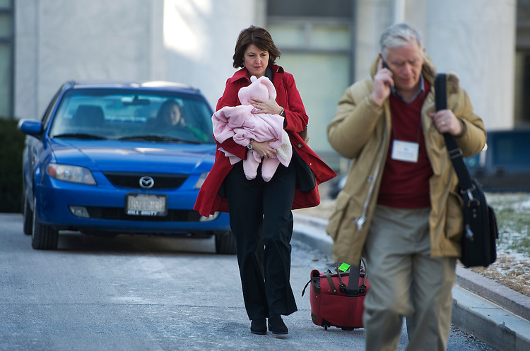 UNITED STATES - JANUARY 13:  Rep. Cathy McMorris Rodgers, R-Wash., arrives at the Rayburn horseshoe with her daughter Grace Blossom, 6 weeks, to buses that will bring Republican members of the House the their annual retreat in Baltimore.  Rep. Mo Brooks, R-Ala., appears at right.  (Photo By Tom Williams/Roll Call)
