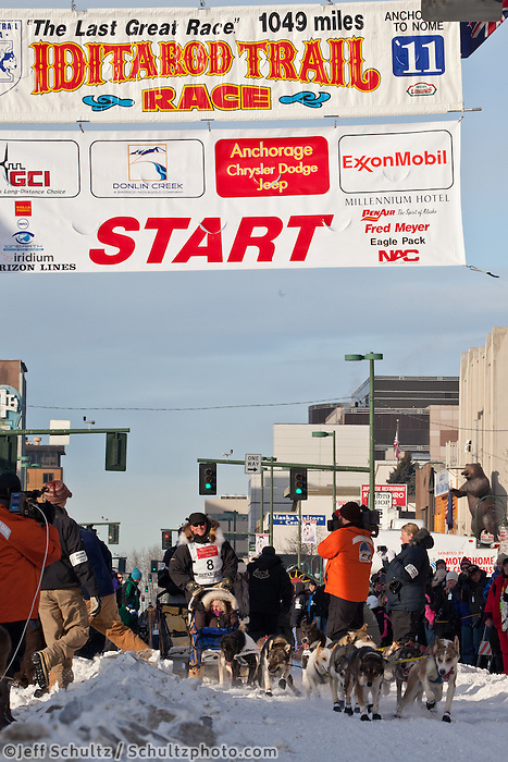Musher Kris Hoffman and Iditarider Thelma Zint.leave the 2011 Iditarod ceremonial start line in downtown Anchorage, Alaska