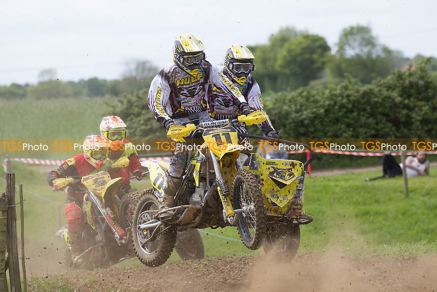 Ross Bowers and Dan Phelps (11) from Neil Campbell and Craig Parmenter during ACU British Sidecar Cross Championship Round Three at Wattisfield Hall MX Track on 22nd May 2016