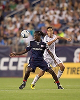 New England Revolution midfielder Shalrie Joseph (21) attempts to control the ball as DC United midfielder Branko Boskovic (27) closes. The New England Revolution defeated DC United, 1-0, at Gillette Stadium on August 7, 2010.