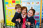 Marion Bowler gets a hug from her grandchildren Shane and Sophie O'Sullivan at the Grandparent day in O'Breannain NS on Tuesday