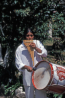 Ecuadorean musician playing traditional bamboo panpipes or rondadores and a drum, Ecuador, South America