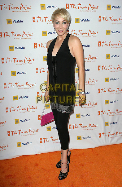 "TERRY MORIS.11th Annual Trevor Project's ""Cracked XMas"" Benefit held at the Wiltern Theatre, Los Angeles, California, USA..December 7th, 2008.full length black leggings top shoes teri terri morris tere pink bag purse .CAP/ADM/TC.©T. Conrad/AdMedia/Capital Pictures."