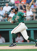 Outfielder Isaac Galloway (24) of the Greensboro Grasshoppers, Class A affiliate of the Florida Marlins, in a game against the Greenville Drive on April 26, 2011, at Fluor Field at the West End in Greenville, South Carolina. (Tom Priddy/Four Seam Images)