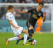 10th September 2017, Liberty Stadium, Swansea, Wales; EPL Premier League football, Swansea versus Newcastle United; Mikel Merino of Newcastle United evades the challenge from Tom Carroll of Swansea City