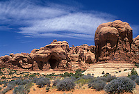 Double Arch sandstone formations in a desert landscape.