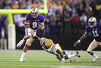 Sept. 5, 2009; Seattle, WA, USA; Washington Huskies wide receiver (9) Devin Aguilar runs the ball past a diving LSU Tigers cornerback (7) Patrick Peterson at Husky Stadium. Mandatory Credit: Mark J. Rebilas-