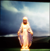 wing Virgin Mary figurine with landscape background