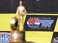 Jun 11, 2017; Englishtown , NJ, USA; Detailed view of an Old Bridge Township Raceway Park logo behind the Wally trophy of NHRA top fuel driver Steve Torrence during the Summernationals. Mandatory Credit: Mark J. Rebilas-USA TODAY Sports