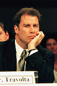 Actor John Travolta listens to testimony before the Commission on Security and Cooperation in Europe, Regarding Discrimination Against Religious Minorities in Germany in Washington, D.C. on September 18, 1997.  Travolta is a member of the Church of Scientology, whose members have encountered religious discrimination in Germany..Credit: Ron Sachs / CNP