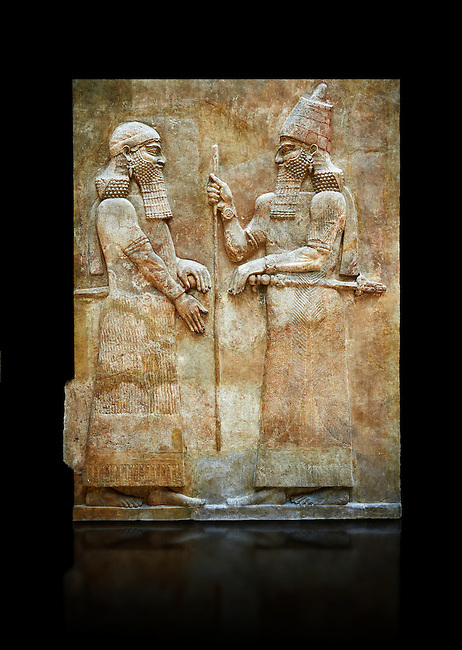 Stone relief sculptured panel of Saron II and a dignitary. Facade L. Inv AO 19873-4 from Dur Sharrukin the palace of Assyrian king Sargon II at Khorsabad, 713-706 BC.  Louvre Museum Room 4 , Paris