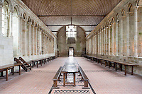 40 metres above the rock, 34 metres long and 10 metres wide, the monk?s refectory with its walls of light and the guests' table in the middle, lies on the same level as the abbey church and the cloister, seen in the distance on the picture, the Merveille (Marvel), 13th century, thanks to a donation by the king of France, Philip Augustus who offered Abbot Jourdain, a grant for the construction of a new Gothic-style architectural set, Le Mont Saint Michel, Manche, Basse Normandie, France. Picture by Manuel Cohen
