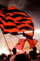 "Flamengo soccer team fans at Maracana stadium in Rio de Janeiro. Flamengo is the most popular team in Brazil and one of the most popular teams in the world. Surveys show that there are over 33 million Flamengo supporters across Brazil. As such, Flamengo supporters are known as ""Nação Rubro-Negra"" (Scarlet-Black Nation), since there are more supporters of Flamengo than the population of many countries. Flamengo supporters are also known for their fanaticism. They hold several records in the Brazilian league like having the best average attendance, or the match with the greatest numbers of attendants between two football clubs."