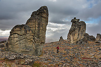 Hiker amidst the weathered granite tors in the Bering Land Bridge National Preserve, Seward Peninsula, Alaska.