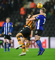 Hull City's Chris Martin vies for possession with Sheffield Wednesday's Tom Lees<br /> <br /> Photographer Chris Vaughan/CameraSport<br /> <br /> The EFL Sky Bet Championship - Hull City v Sheffield Wednesday - Saturday 12th January 2019 - KCOM Stadium - Hull<br /> <br /> World Copyright © 2019 CameraSport. All rights reserved. 43 Linden Ave. Countesthorpe. Leicester. England. LE8 5PG - Tel: +44 (0) 116 277 4147 - admin@camerasport.com - www.camerasport.com