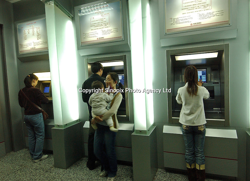 People get money from ATM's Guangzhou,  China..