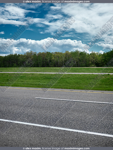 Trans-Canada highway going through Manitoba, Artistic outdoor scenery with dramatic colors and textures. Manitoba, Canada.