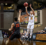 SIOUX FALLS, SD - MARCH 9:  Sterling Brown #10 from Marian gets a jumper off over Nic Williams #20 from Indiana Tech during their second round game at the 2018 NAIA DII Men's Basketball Championship at the Sanford Pentagon in Sioux Falls. (Photo by Dave Eggen/Inertia)