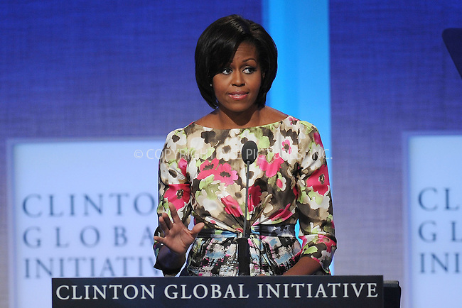WWW.ACEPIXS.COM . . . . . .September 23, 2010...New York City...Michelle Obama speaks at the Clinton Global Initiative annual meeting in New York  on September 23, 2010 in New York City....Please byline: KRISTIN CALLAHAN - ACEPIXS.COM.. . . . . . ..Ace Pictures, Inc: ..tel: (212) 243 8787 or (646) 769 0430..e-mail: info@acepixs.com..web: http://www.acepixs.com .