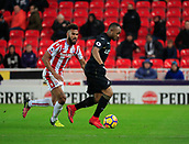 2nd December 2017, bet365 Stadium, Stoke-on-Trent, England; EPL Premier League football, Stoke City versus Swansea City; Jordan Ayew of Swansea City tries to escape from Eric Maxim Choupo-Moting of Stoke City