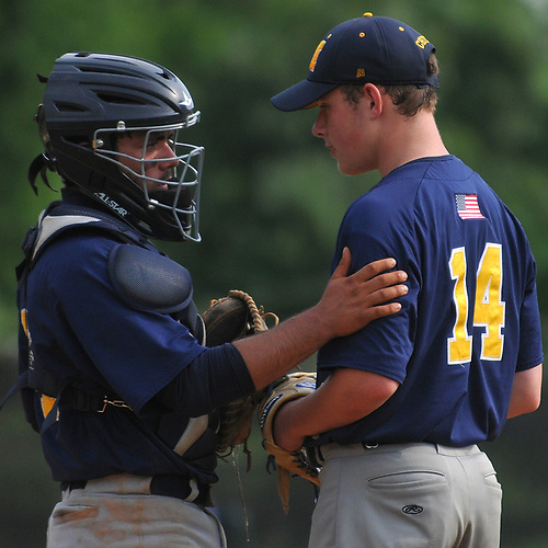 Andrew Primm #24, Massapequa catcher, left, chats with pitcher Dan Wolf #14 during Game 1 of the best-of-three Nassau County varsity baseball Class AA final against Oceanside at SUNY Old Westbury on Saturday, May 26, 2018. Massapequa won 6-5.