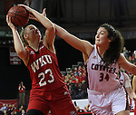 VERMILLION, SD - MARCH 27, 2016 -- Kate Liveringhouse #34 of South Dakota tries to block Ivy Brown #23 of Western Kentucky during their WNIT game Sunday evening at the Dakotadome in Vermillion, S.D.  (Photo by Dick Carlson/Inertia)